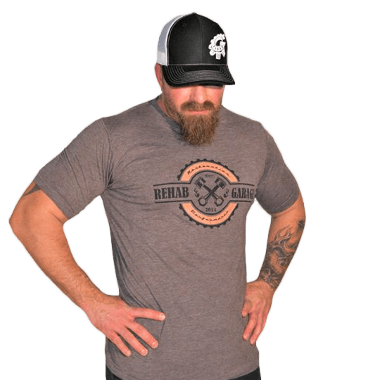 Rehab Garage grey t-shirt, wearing a black hat transparent background